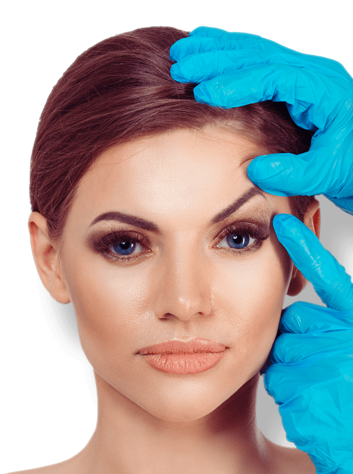 Surgeon points to a woman's brow