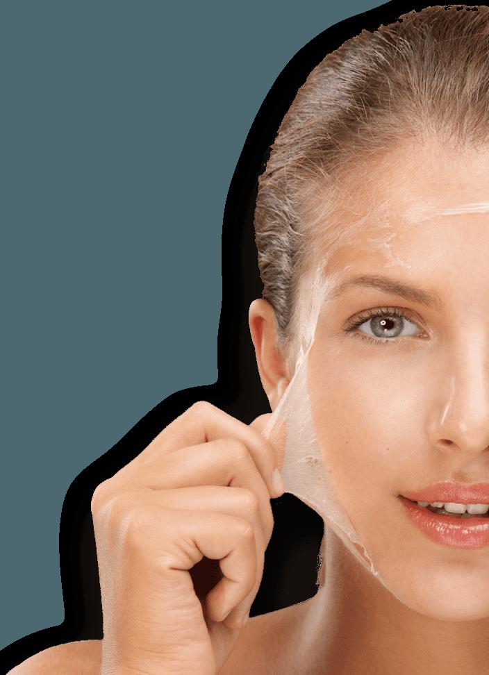 Woman peeling off face mask