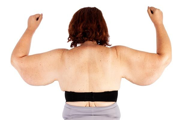 Woman's back with arms raised