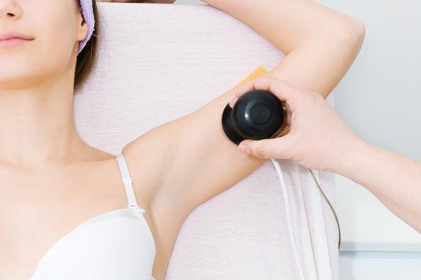 Woman undergoing skin treatment