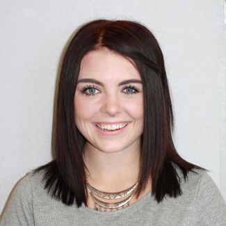 smiling girl with dark hair