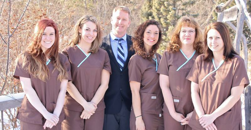 Dentist and staff at Woodland Family Dental