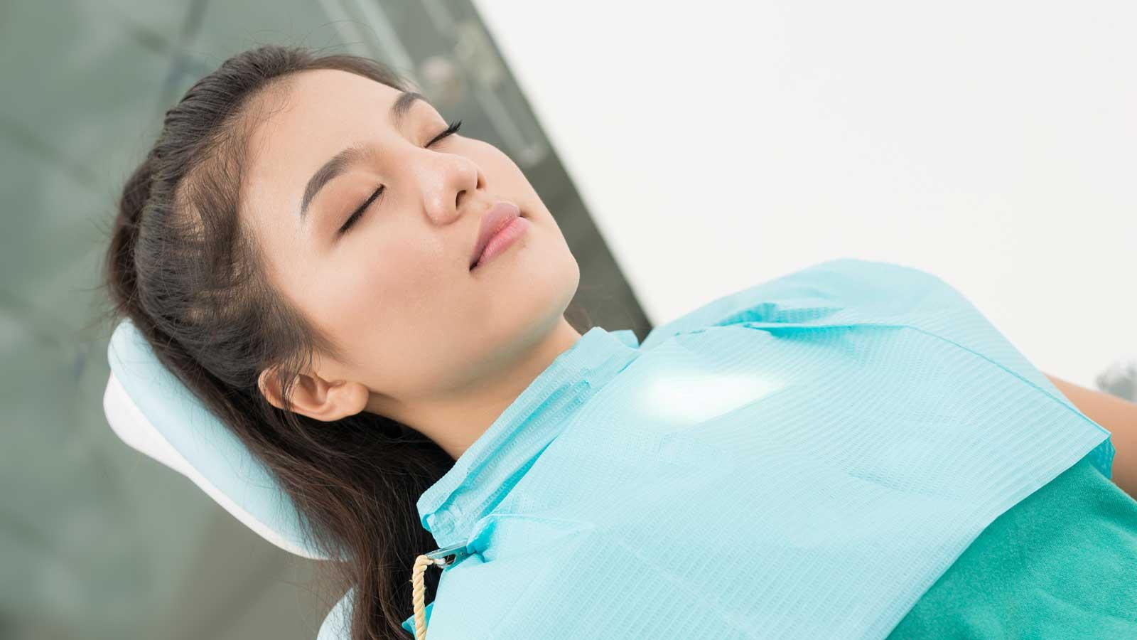 Sedated female dental patient